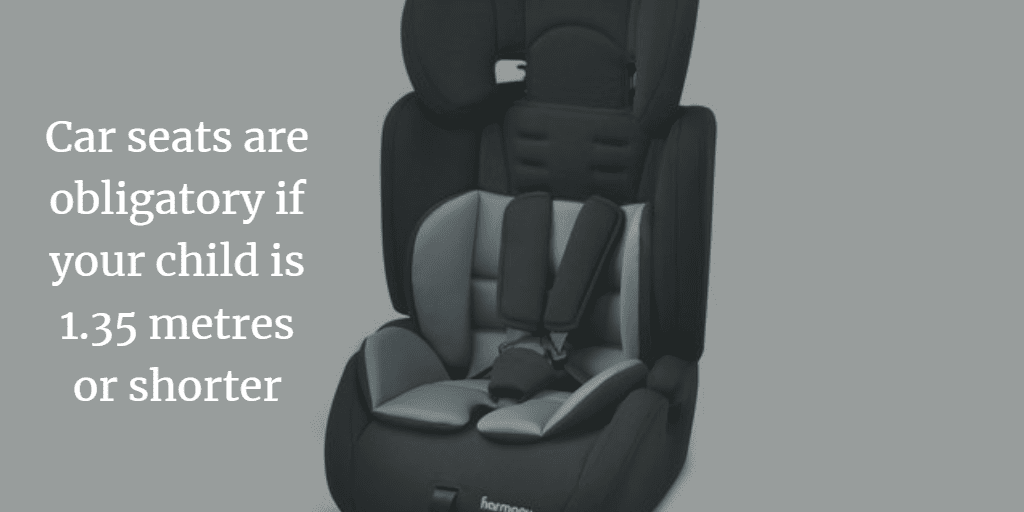 Can children sit in the front seat in Spain?